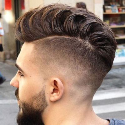 Loose Pompadour Hairstyle With High Fade
