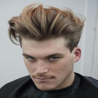 Popular hairstyles for guys: Back Swept Medium Length Hairdo With Long Fringe