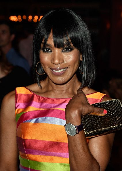 Angela Bassett's -Hairstyles for over 50 with glasses
